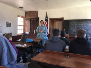 one room schoolteacher teaching at schoolhouse