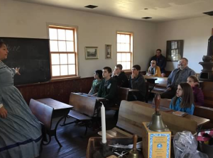 one room schoolteacher at historic 1850 schoolhouse